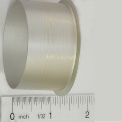 picture of small diameter gold wire on a spool